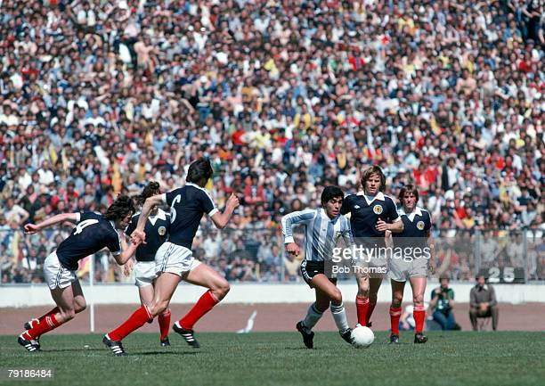 Argentina's Diego Maradona surrounded by 5 Scottish players during a friendly international match at Hampden Park Glasgow 2nd June 1979 Scottish...