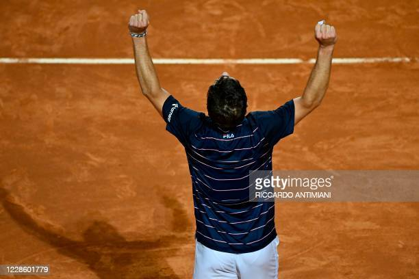 Argentina's Diego Schwartzman celebrates after defeating Spain's Rafael Nadal in their quarter final match of the Men's Italian Open at Foro Italico...