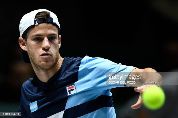 Argentina's Diego Schwartzman eyes the ball as he returns the ball to Spain's Rafael Nadal during the singles quarter-final tennis match between...