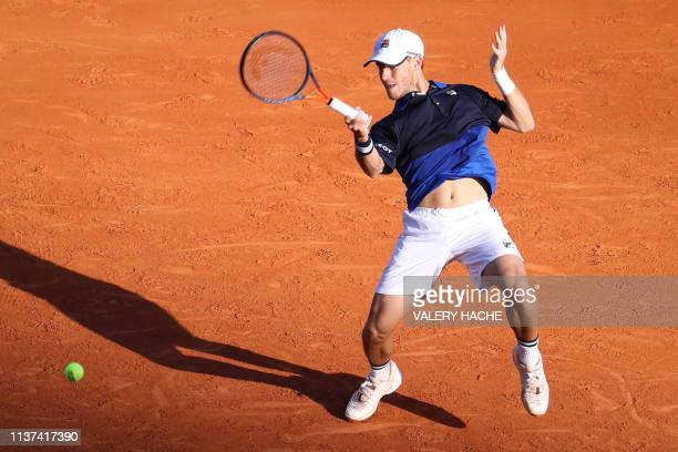 Argentina's Diego Schwartzman plays a forehand return to Britain's Kyle Edmund during their tennis match on the day 3 of the Monte-Carlo ATP Masters...