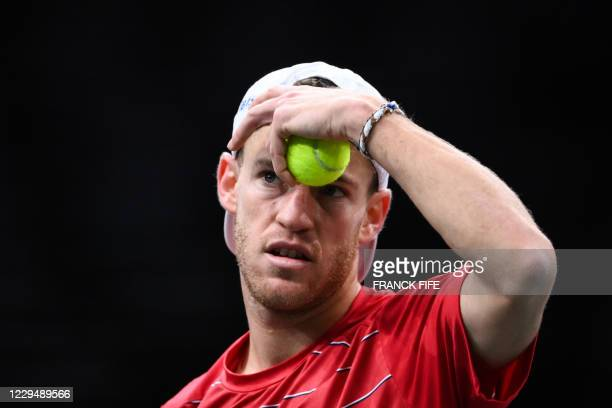Argentina's Diego Schwartzman reacts as he plays against Russia's Daniil Medvedev during their men's singles quarter-final tennis match on day 5 at...
