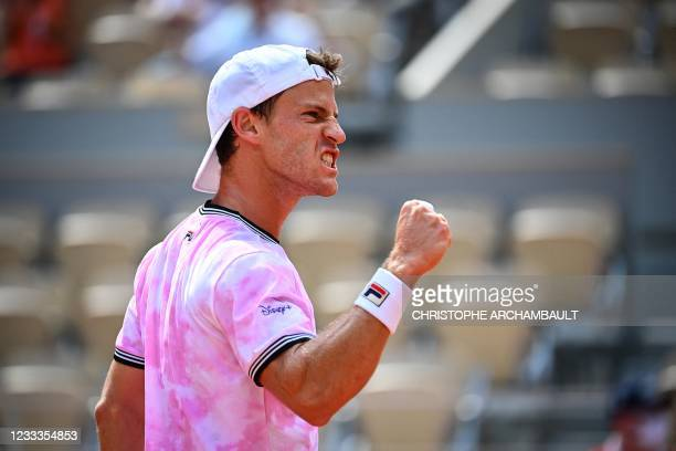 Argentina's Diego Schwartzman reacts as he plays against Spain's Rafael Nadal during their men's singles quarter-final tennis match on Day 11 of The...