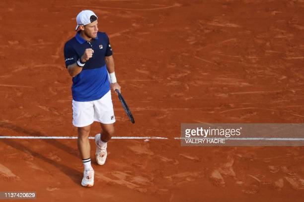Argentina's Diego Schwartzman reacts during his tennis match against Britain's Kyle Edmund on the day 3 of the Monte-Carlo ATP Masters Series...