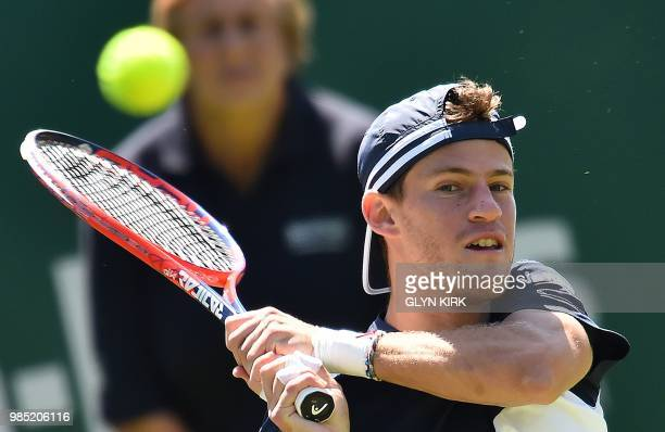 Argentina's Diego Schwartzman returns against Slovakia's Lukas Lacko during their Men's singles second round match at the ATP Nature Valley...
