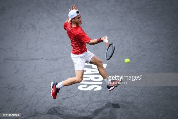 Argentina's Diego Schwartzman returns the ball to France's Richard Gasquet during their men's singles second round tennis match on day 3 at the ATP...