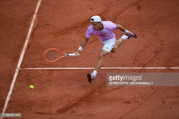 Argentina's Diego Schwartzman returns the ball to Germany's Philipp Kohlschreiber during their men's singles third round tennis match on Day 7 of The...