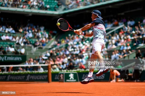 Argentina's Diego Schwartzman returns the ball to Spain's Rafael Nadal during their men's singles quarter-final match on day twelve of The Roland...