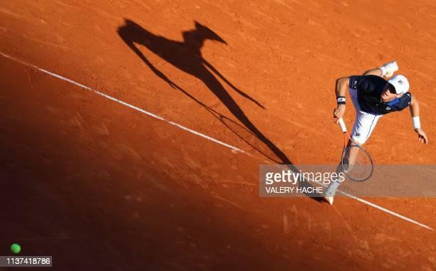 Argentina's Diego Schwartzman serves against Britain's Kyle Edmund during their tennis match on the day 3 of the MonteCarlo ATP Masters Series...