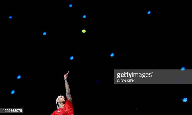 Argentina's Diego Schwartzman serves to Germany's Alexander Zverev in their men's singles round-robin match on day four of the ATP World Tour Finals...