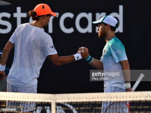 Argentina's Diego Schwartzman shakes hands as he celebrates after victory over Ukraine's Alexandr Dolgopolov Jr during their men's singles third...