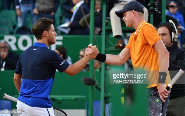 Argentina's Diego Schwartzman shakes hands with Britain's Kyle Edmund after winning their tennis match on the day 3 of the MonteCarlo ATP Masters...