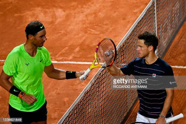 Argentina's Diego Schwartzman taps the racket of Spain's Rafael Nadal after he won their quarter final match of the Men's Italian Open at Foro...