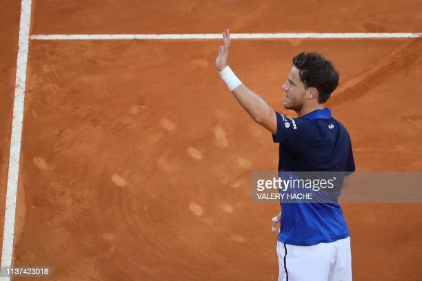 Argentina's Diego Schwartzman waves to the audience after winning his tennis match against Britain's Kyle Edmund on the day 3 of the MonteCarlo ATP...