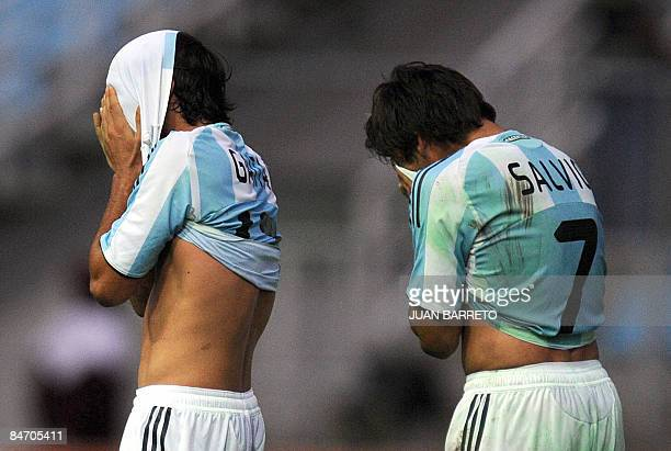 "Argentina's Eduardo Salvio and Cristian Gaitan react after losing their U-20 South American Championship football match against Colombia at the ""Jose..."