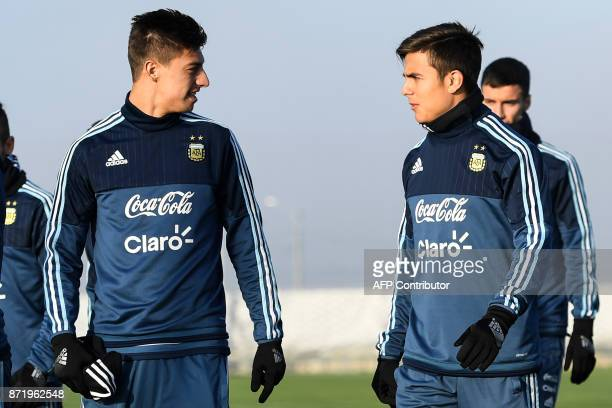 Argentina's Emiliano Rigoni and Paulo Dybala take part in a training session in Moscow on November 9 2017 The team will face Russia and Nigeria in...