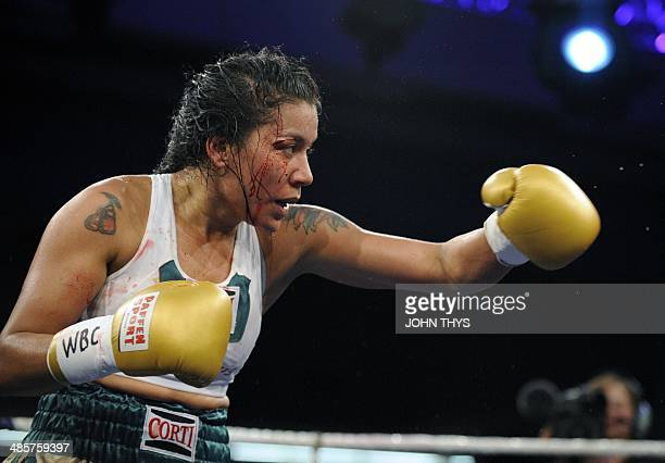 Argentina's Erica Anabella Farias aka 'La Pantera' throws a punch during the women's lightweight World Cup final boxing match of the WBC...