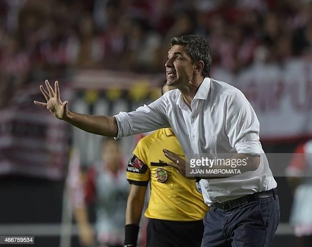 Argentina's Estudiantes de La Plata coach Mauricio Pellegrino gestures during the Copa Libertadores 2015 group 7 football match against Paraguay's...