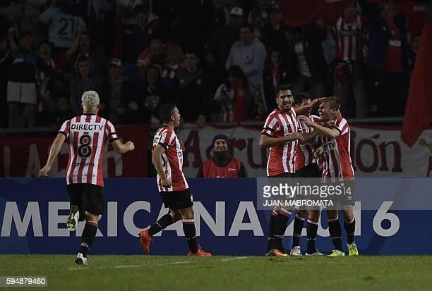 Argentina's Estudiantes de La Plata defender Facundo Sanchez celebrates with teammates midfielder Augusto Solari forward Lucas Viatri midfielder...