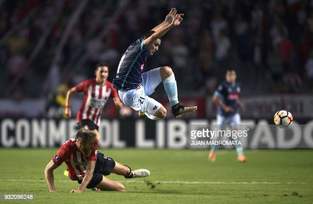 Argentina's Estudiantes de La Plata defender Jonatan Schunke vies for the ball with Peru's Real Garcilaso forward Oscar Franco during their Copa...