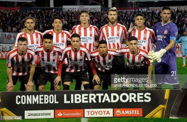 Argentina's Estudiantes de La Plata football team players pose before their Copa Libertadores round of sixteen first leg football match against...