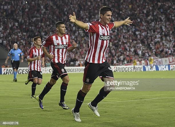 Argentina's Estudiantes de La Plata forward Guido Carrillo celebrates followed by teammates after scoring his third goal against Ecuador's Barcelona...
