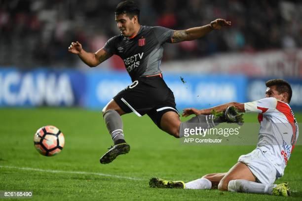 Argentina's Estudiantes de la Plata midfielder Javier Iritier vies for the ball with Bolivia's Potosi defender Miguel Angel Hoyos during their Copa...