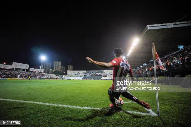 TOPSHOT Argentina's Estudiantes de La Plata midfielder Lucas Rodriguez shoots a corner kick during their Copa Libertadores group F football match...