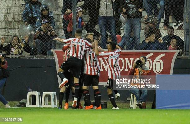 Argentina's Estudiantes de La Plata players celebrate a goal against Brazil's Gremio during their Copa Libertadores round of sixteen first leg...