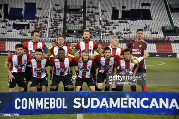 Argentina's Estudiantes de la Plata players pose before their 2017 Copa Sudamericana football match against Paraguay's Nacional at Defensores del...