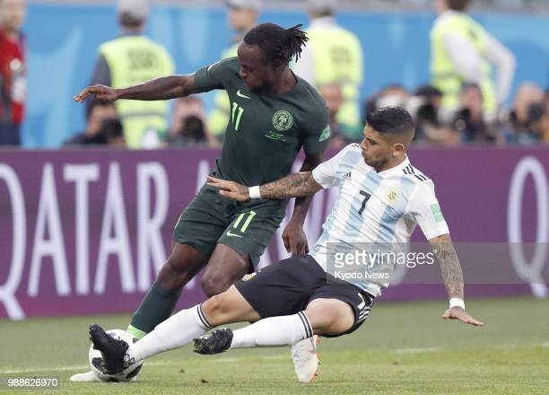 Argentina's Ever Banega and Nigeria's Victor Moses vie for the ball during a World Cup Group D match in St Petersburg Russia on June 26 2018...