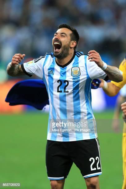 Argentina's Ezequiel Lavezzi celebrates victory after the penalty shootout