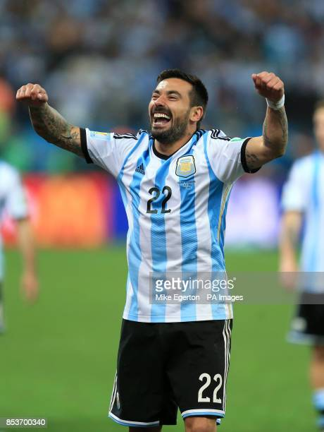 Argentina's Ezequiel Lavezzi celebrates victory in the penalty shootout with teammates following the FIFA World Cup Semi Final at the Arena de Sao...