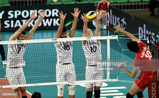Argentina's Facundo Conte Martin Ramos and Jose Luis Gonzalez block during the FIVB World Championships match between Argentina and Iran on September...
