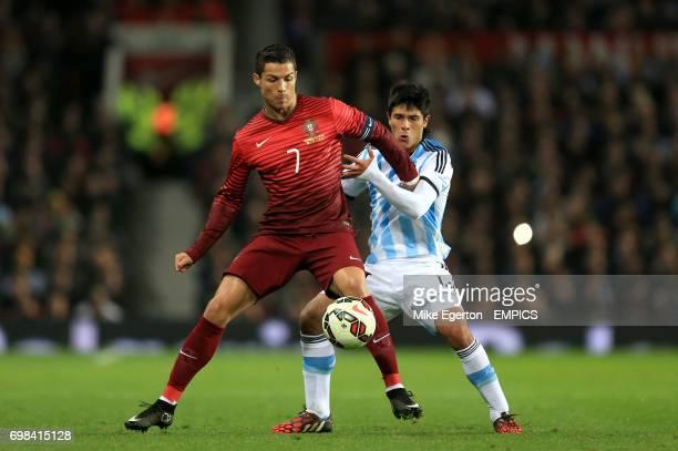 Argentina's Facundo Roncaglia and Portugal's Cristiano Ronaldo battle for the ball
