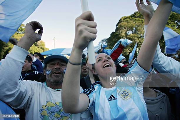 Argentina's fans celebrate a goal during the FIFA World Cup South Africa 2010 match between Argentina and Greece as they watch it on an outdoor...