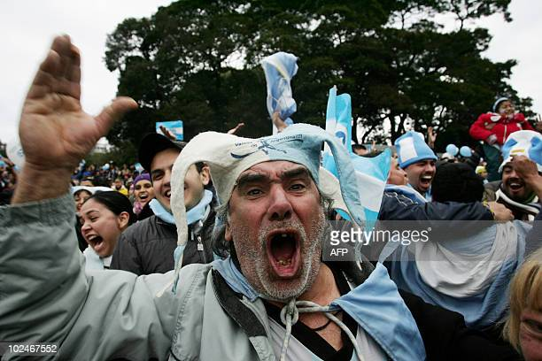 Argentina's fans celebrate as they watch the FIFA World Cup South Africa 2010 football match between Argentina and Mexico on an outdoor screen in...