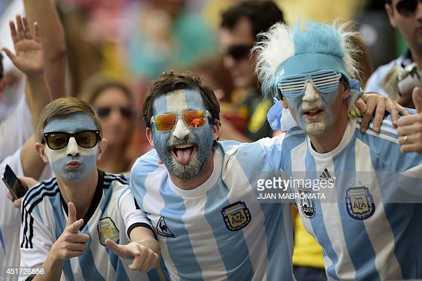 Argentina's fans cheer before a quarterfinal football match between Argentina and Belgium at the Mane Garrincha National Stadium in Brasilia during...