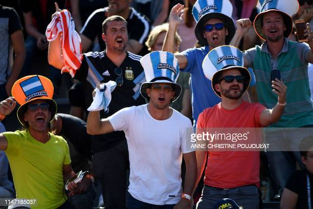 Argentina's fans cheer during the men's singles third round match between Argentina's Juan Ignacio Londero and France's Corentin Moutet on day six of...