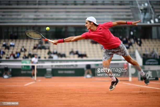 Argentina's Federico Coria returns the ball to France's Benoit Paire during their men's singles second round tennis match on Day 4 of The Roland...