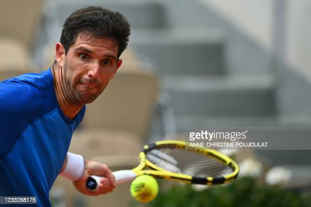 Argentina's Federico Delbonis returns the ball to Italy's Fabio Fognini during their men's singles third round tennis match on Day 6 of The Roland...