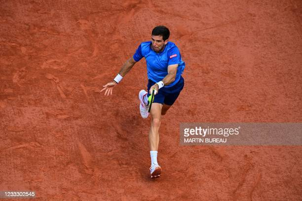 Argentina's Federico Delbonis returns the ball to Spain's Alejandro Davidovich Fokina during their men's singles fourth round tennis match on Day 8...