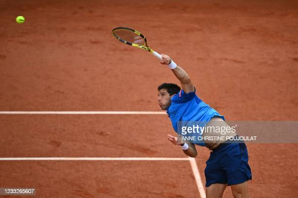 Argentina's Federico Delbonis serves the ball to Italy's Fabio Fognini during their men's singles third round tennis match on Day 6 of The Roland...