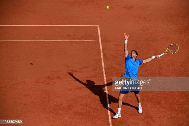 Argentina's Federico Delbonis serves the ball to Spain's Alejandro Davidovich Fokina during their men's singles fourth round tennis match on Day 8 of...