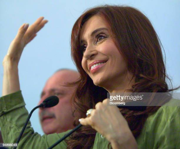 Argentina's First Lady Cristina Fernandez de Kirchner waves during a press conference after winning a seat in the Senate in elections in Buenos Aires...