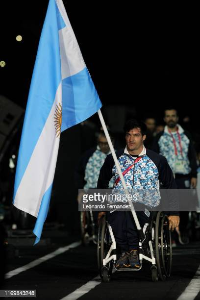Argentina´s flag-bearer, tennis player, Gustavo Fernandez leads his delegation during the Parade of Nations during the opening ceremony of Parapan...