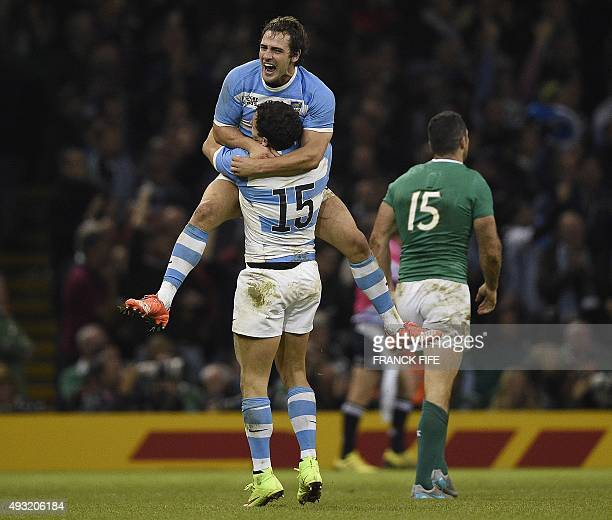 Argentina's fly half Nicolas Sanchez celebrates with Argentina's fullback Joaquin Tuculet after their fourth try during a quarter final match of the...