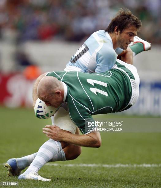 Argentina's fly-half Juan Martin Hernandez tackles Ireland's winger Denis Hickie during the Rugby union World Cup pool D match Ireland vs Argentina,...