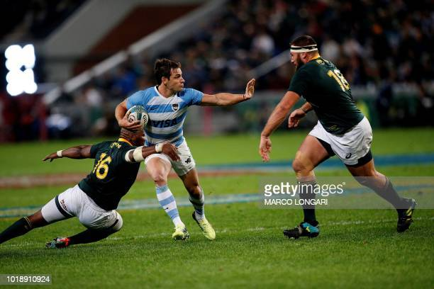 Argentina's flyhalf Nicolas Sanchez is tackled by South Africa hooker Bongi Mbonambi and South Africa's prop Thomas du Toit during The Rugby...