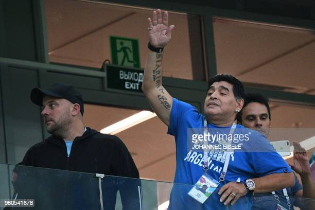 Argentina's football legend Diego Maradona gestures in the grandstand before the Russia 2018 World Cup Group D football match between Argentina and...