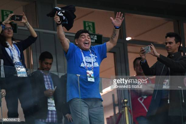 TOPSHOT Argentina's football legend Diego Maradona gestures in the grandstand before the Russia 2018 World Cup Group D football match between...